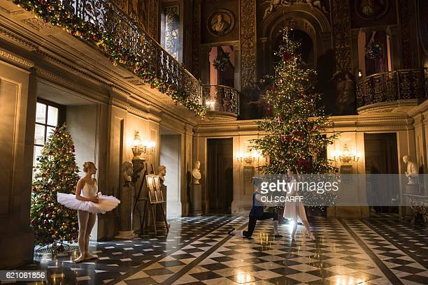 Ballet dancers Daisy Kerry Benjamin Jones and Daisy Edwards pose in the Painted Hall of Chatsworth House which is decorated for their Christmas...