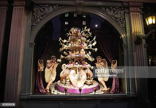Ballet dancers from Sadler's Wells Theatre pose in the newly unveiled Christmas window of Fortnum Mason grocery store on November 6 2009 in Picadilly...