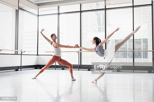 Ballet dancers in rehearsal studio