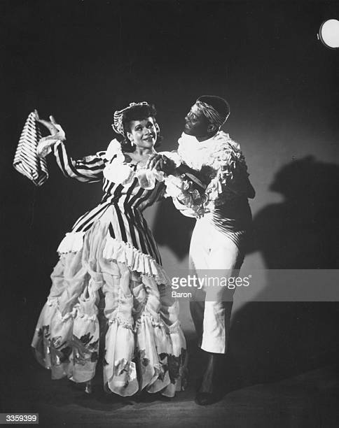 Ballet dancers Katherine Dunham and Vanoye Aikens in Dunham's ballet 'L'Ag' Ya' at the Prince of Wales Theatre in London 1948