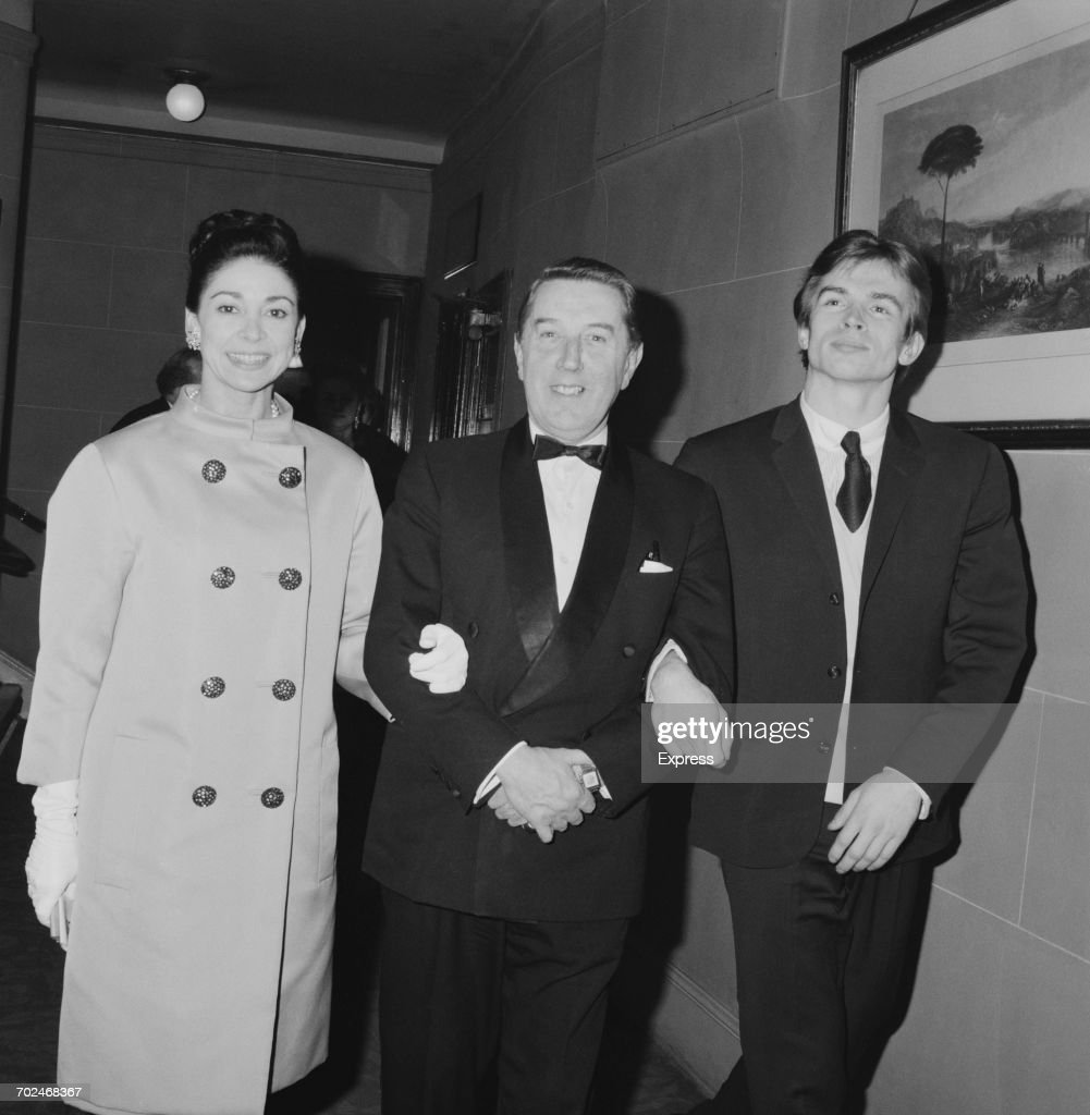 Ballet dancers Margot Fonteyn (left) and Rudolf Nureyev (right) arm in arm with choreographer Frederick Ashton (centre), UK, 2nd March 1964.