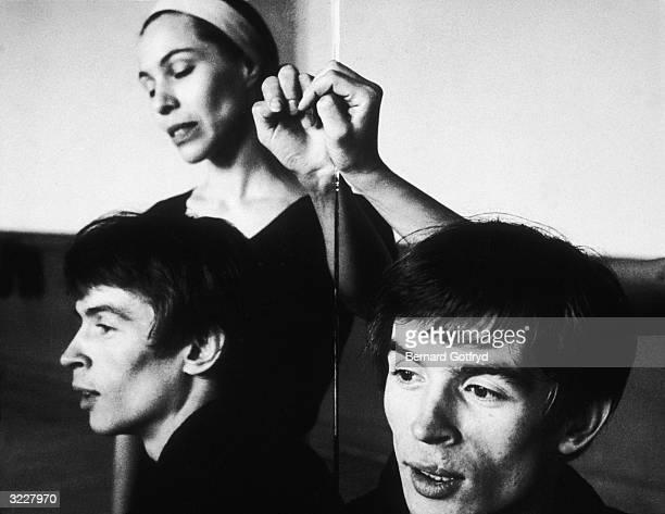 Ballet dancers Maria Tallchief and Rudolf Nureyev are reflected in a mirror in a dance studio