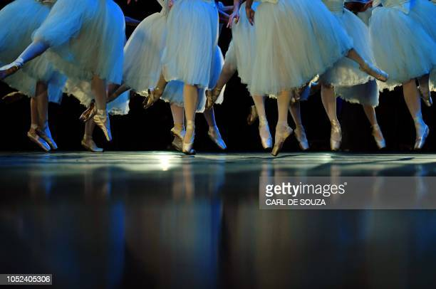 Ballet dancers perform during a rehearsal before the opening night of a Ballet production at the Municipal Theater in Rio de Janeiro Brazil on June...