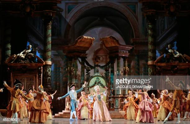 Ballet dancers perform during the dress rehearsal of act III ''the Sleeping Beauty'' on December 2 2013 at the Opera Bastille in Paris Late dancer...