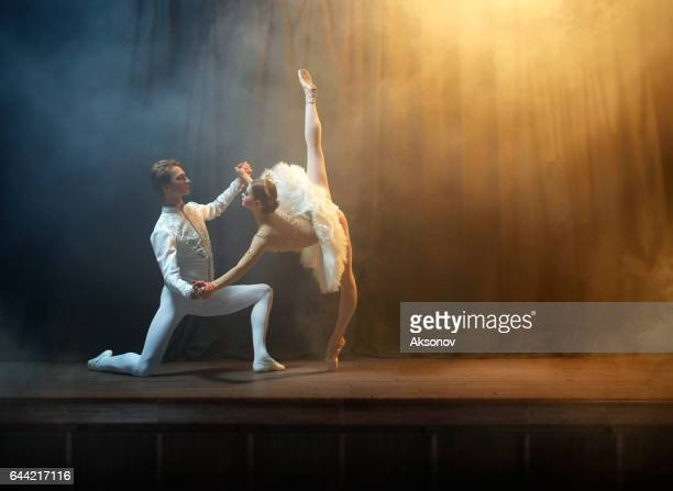 Ballet dancers performing on stage in theatre