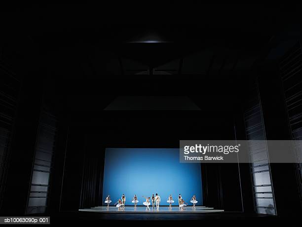 ballet dancers performing on stage - theatrical performance photos et images de collection