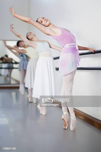ballet dancers posing at barre - barre class stock photos and pictures