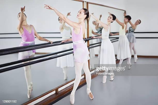 ballet dancers posing at barre - ballettstudio stock-fotos und bilder