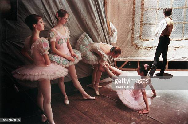 Ballet dancers prepare off stage for a performance at the Bloshoi Theater in Moscow