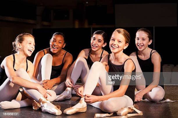 ballet dancers putting on slippers - leotard stock photos and pictures