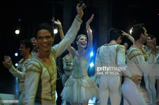 Ballet dancers react after performing on the opening night of a Ballet production at the Municipal Theater in Rio de Janeiro Brazil on June 23 2018...
