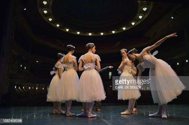 Ballet dancers rehearse before the opening night of a Ballet production at the Municipal Theater in Rio de Janeiro Brazil on June 20 2018 In 2017 the...