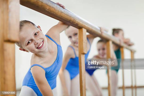 ballet dancers standing at barre - barre class stock photos and pictures
