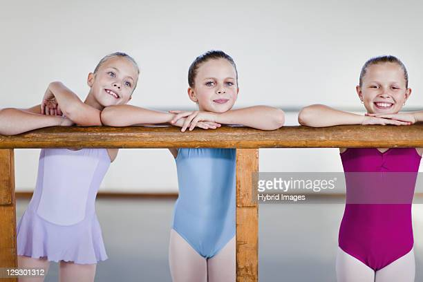 ballet dancers standing at barre - little girls leotards stock photos and pictures