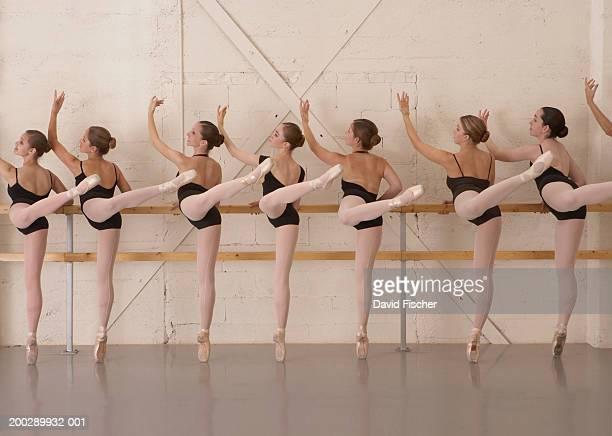 ballet dancers standing on toes in ballet studio, rear view - ballettstudio stock-fotos und bilder