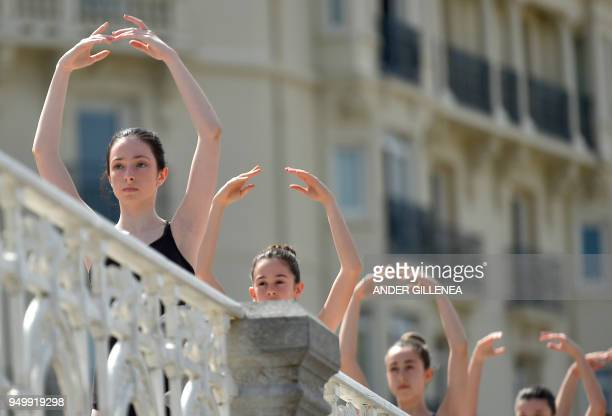 Ballet dancers take part in a classic dance exhibition gathering some 1400 participants to celebrate the Month of The Dance in La Concha bay in the...