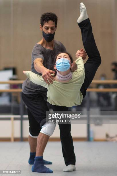 Ballet dancers take part in a rehearsal at the Birmingham Royal Ballet in Birmingham on May 20, 2021. - Cuban ballet star Carlos Acosta is staging...