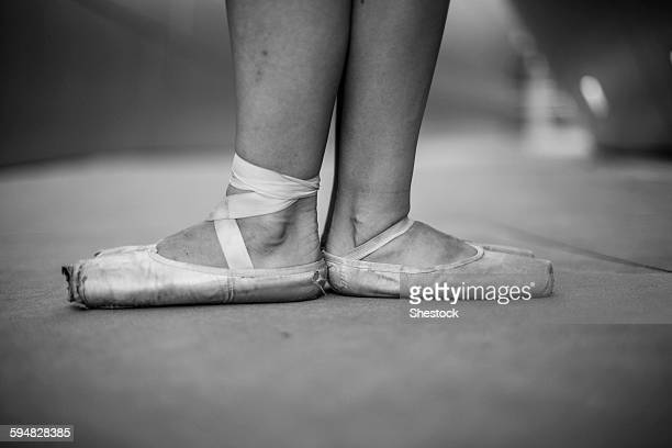 Ballet dancers wearing pointe shoes