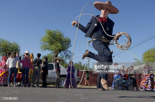 TOPSHOT Ballet Folklorico dancers prepare to march in a homecoming parade for Heavyweight boxing champion Andy Ruiz Jr on June 22 2019 in Imperial...