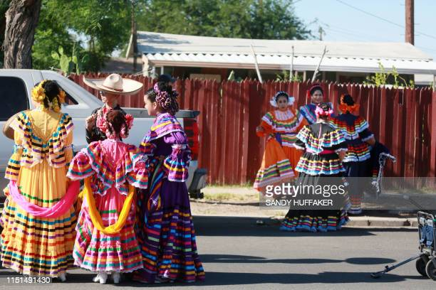 Ballet Folklorico dancers prepare to march in a homecoming parade for Heavyweight boxing champion Andy Ruiz Jr on June 22 2019 in Imperial California...