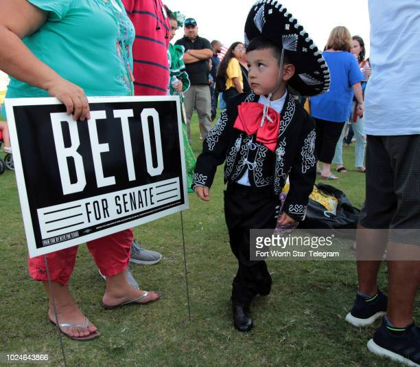 Ballet Folklorico de Fort Worth member Vicente Bonilla of Fort Worth dances even while off stage at a rally for Beto O'Rourke on Sunday Aug 26 2018...