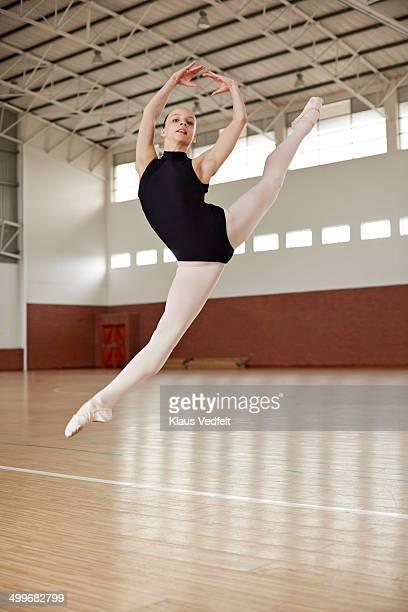 Ballet girl making high jump