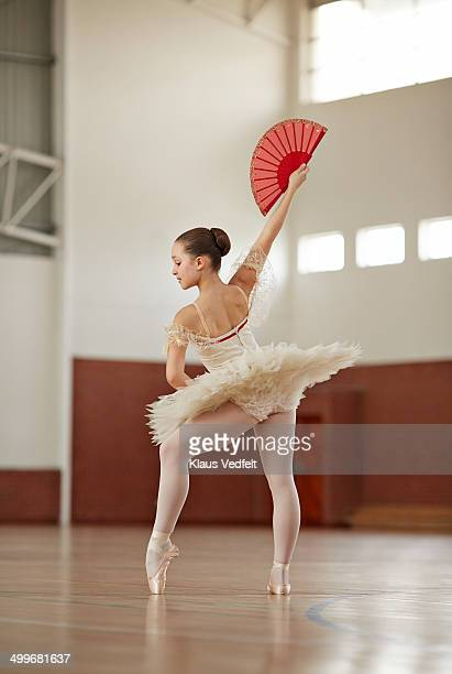 Ballet girl posing in gymnasium