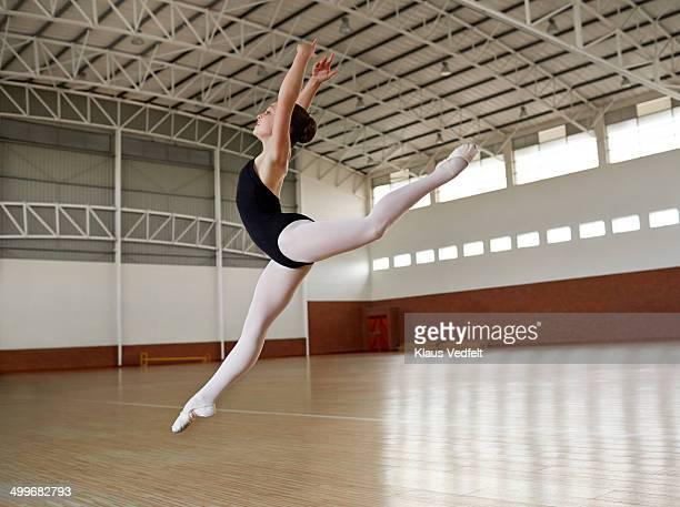 Ballet girl practicing jump