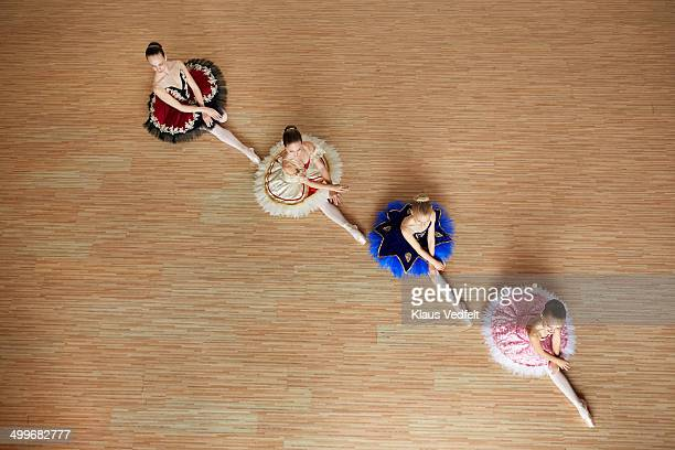 Ballet girls posing sitting, top view