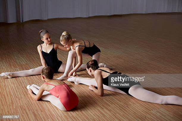 Ballet girls streching before training