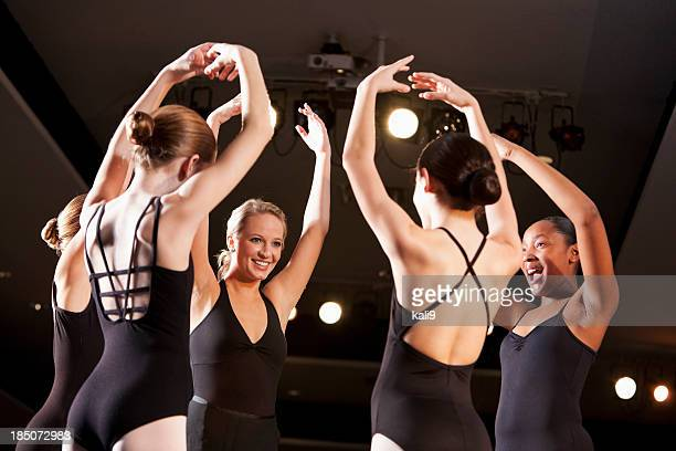 ballet instructor with students on stage in auditorium - little girls leotards stock photos and pictures