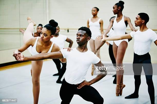 Ballet partners in rehearsal in dance studio