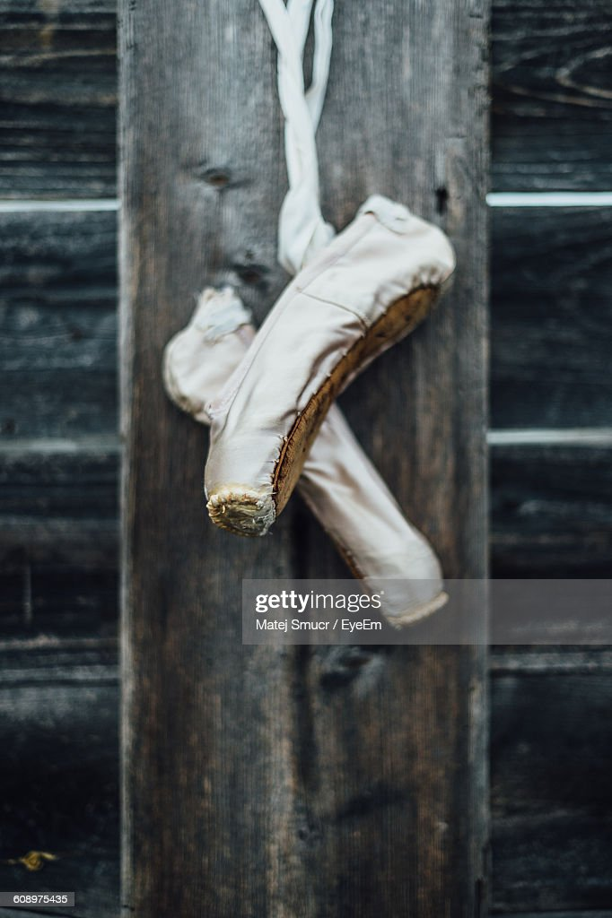 14f2fd2d3f2a Ballet Shoes Hanging From Wooden Wall Stock Photo - Getty Images