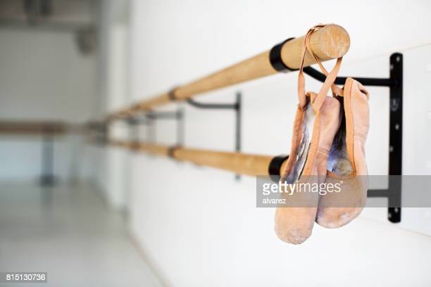 ballet shoes hanging on wooden barre in studio - dance studio stock pictures, royalty-free photos & images