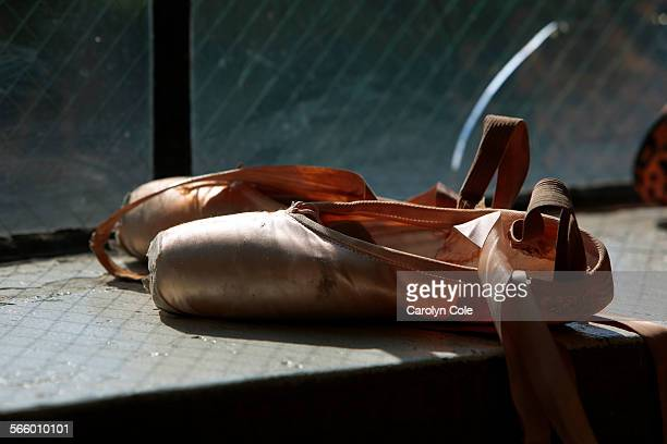 Ballet shoes sit in the window at the Everett Center for Performing Arts where dancers rehears for The Dance Theater of Harlem The Dance Theater of...