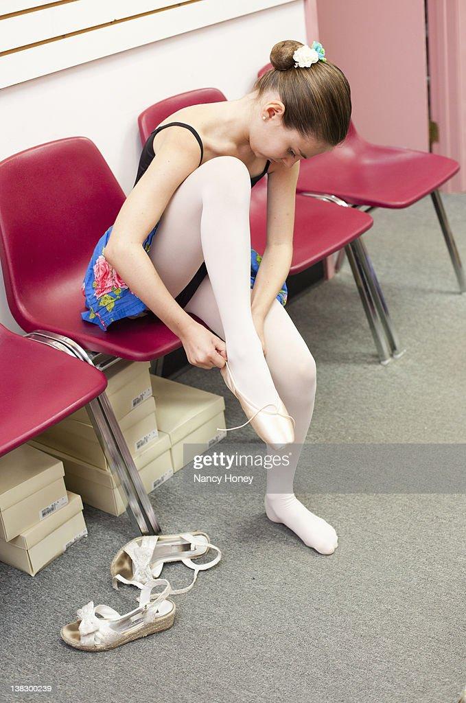 Ballet student tying slippers : Stock Photo