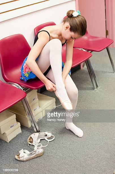 ballet student tying slippers - pantyhose photos stock photos and pictures