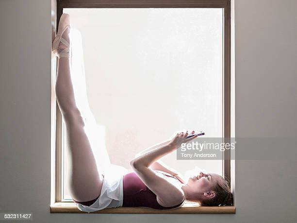 Ballet student with phone downtime