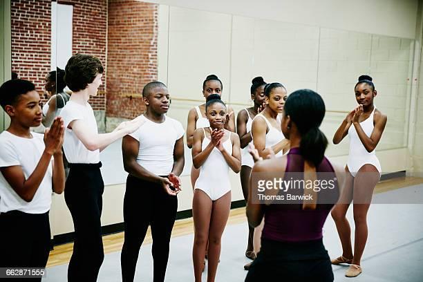 Ballet students applauding instructor