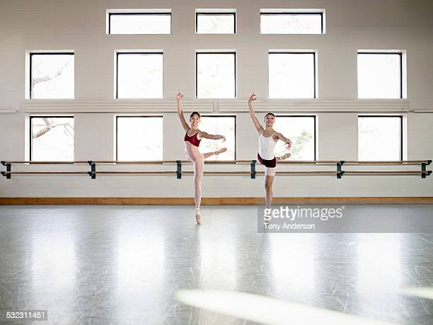ballet students rehearsing in studio - ballettstudio stock-fotos und bilder