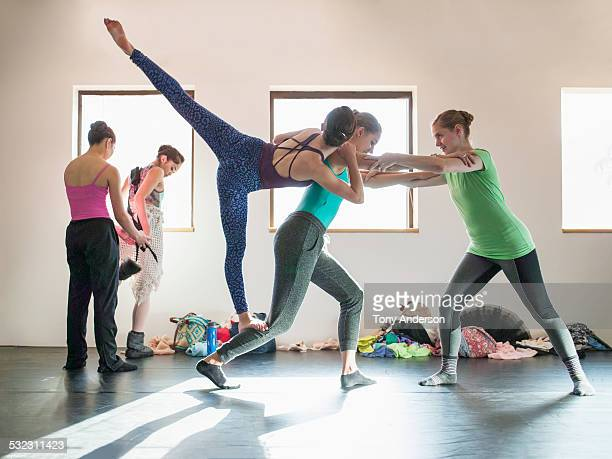 Ballet students working between classes