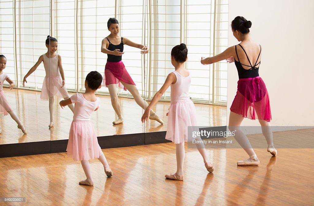 Ballet teaching young ballerinas : Stock Photo