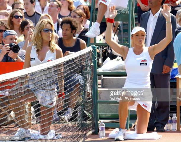 Ballgirls Penny Lancaster and Nell McAndrew during Tim Henman and Jonathan Ross' match at the smashed Ariel Champions of the Future celebrity tennis...