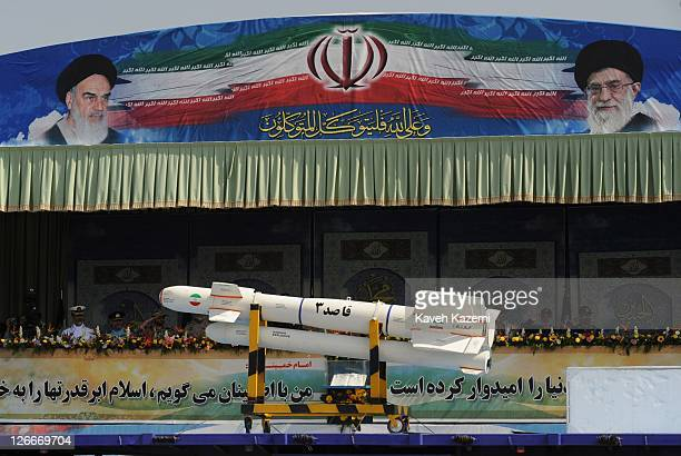 A ballistic missile is paraded past a podium from which Major General Hassan Firoozabadi and other military commanders observe a parade commemorating...