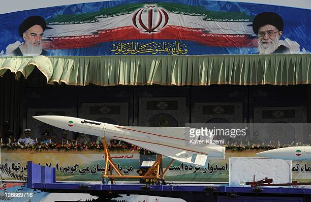 Ballistic missiles are paraded past a podium from which Major General Hassan Firoozabadi and other military commanders observe a parade commemorating...