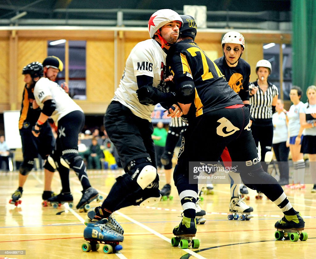 Ballistic of Southern Discomfort and Bob-Omb of Tyne and Fear bout in the Men's European Cup roller derby tournament at Walker Activity Dome on August 31, 2014 in Newcastle upon Tyne, England.