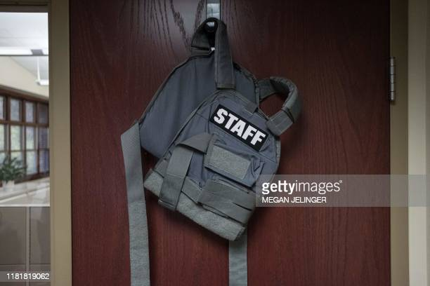 A ballistic vest hangs in superintendent Robert Humble's office to be worn in case of an active shooter for protection and to identify staff members...