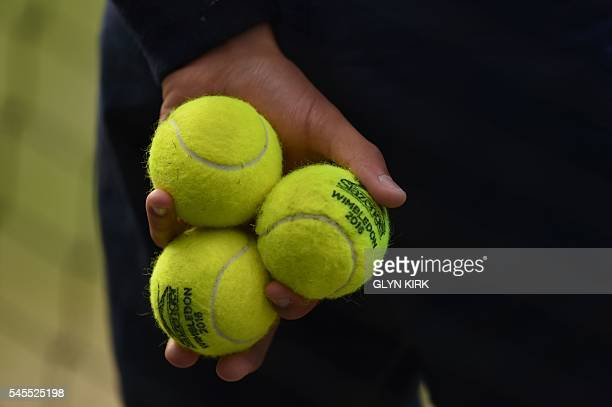 A ballkid holds tennis balls on centre court as Czech Republic's Tomas Berdych plays against Britain's Andy Murray during their men's singles...