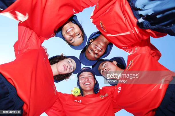 Ballkids pose in a huddle during the 2019 Australian Open Ballkids launch at Melbourne Park on December 11 2018 in Melbourne Australia