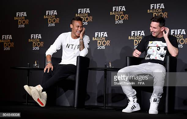 Ballon dOr 2015 nominees Neymar of Brazil and FC Barcelona and Lionel Messi of Argentina and FC Barcelona share a joke during the FIFA Ballon dOr...